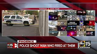 Armed suspect in critical condition after being shot by Phoenix police Friday - Video
