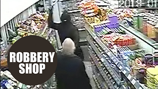 Dramatic CCTV shows have-a-go-hero shopkeeper fighting off robbers with HAMMERS - Video