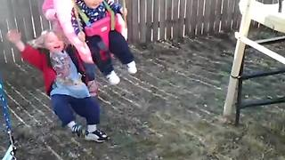 Little Girl Gets Knocked Over By A Swing - Video