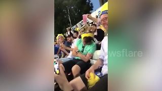 Funny moment cricket fans stack drinks on a sleeping fan