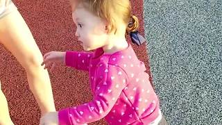 Cute Girl Gets Dizzy In A Playground