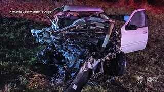Deputy removes driver from burning vehicle after crash
