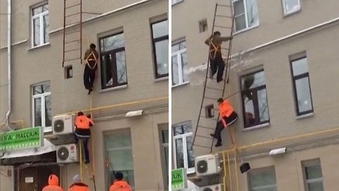 Hapless repairmen bring ladder crashing to the ground after pulling it off roof