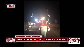 One dead after car collides with train - Video