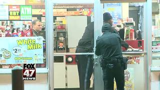 Man holds-up Quality Dairy at gunpoint, flees - Video