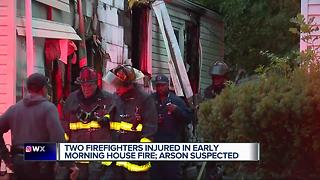 Two firefighters injured fighting house fire - Video