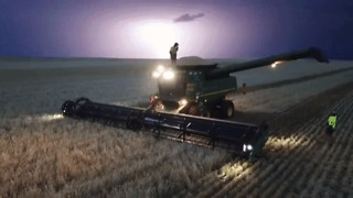 Aerial Footage Shows Man Dancing on Top of a Harvester During a Lightning Storm - Video