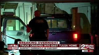 Truck crashes into East Tulsa home