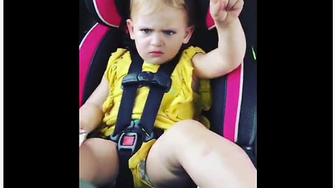 Little girl not amused with dad's prank