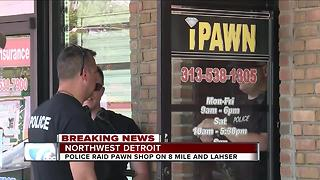 FBI raids pawn shop in northwest Detroit - Video