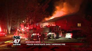 Lansing Police rescue students trapped in massive house fire, firefighter injured - Video
