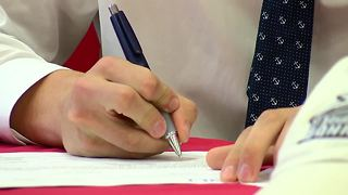 Ben Mazur signs scholarship - Video