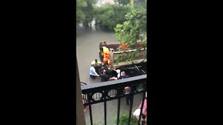 Neighbours Make Human Chain To Rescue Woman In Labour From Floods - Video