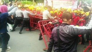 May Day Protesters Push Against Police Barricades in Jakarta - Video