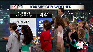 Girl Scouts help do the wx