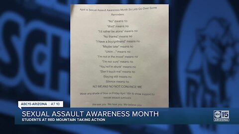 Red Mountain High School students post anti-sexual harassment flyers on campus