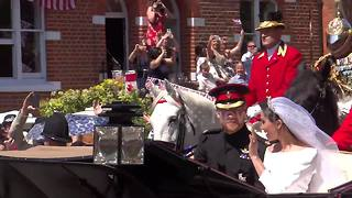 Crowds greet newlyweds Prince Harry and Meghan Markle after their marriage ceremony - Video