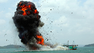 Sinking Ships: Indonesia Battles Illegal Fishing By Blowing Up Impounded Boats - Video