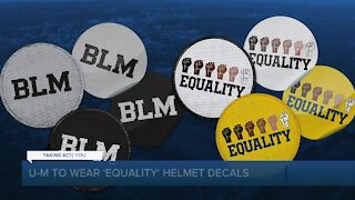 Michigan to display helmet decals with the word 'Equality' and raised fists