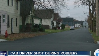 Cab driver shot during robbery - Video