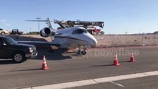 Jet aircraft rolls through fence at US airport - Video