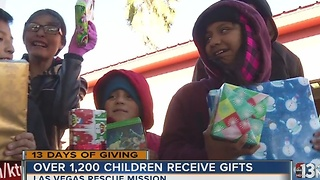 Hundreds of children receive toys at 13 Days of Giving toy giveaway - Video