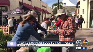 People donate food, receive South Florida Fair tickets - Video