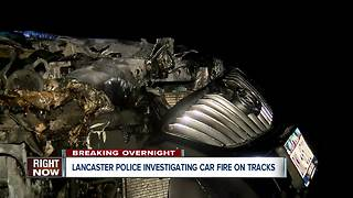 Lancaster police investigating overnight car fire on train tracks - Video