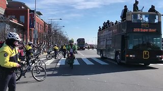Jason Kelce Rides a Police Bike During Philadelphia Eagles Homecoming Parade - Video