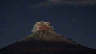 Beautiful Time-Lapse Shows Volcano Eruption on a Starry Night - Video