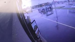 Surveillance video shows truck slam into Warren bus stop, injuring 6 - Video