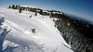 Breathtaking moment avalanche drags snowboarder 100 metres down hill - Video