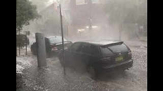 Streams of Hail Flow Down Street as Storms Hit Sydney