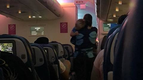Viral Video Shows Flight Attendant Calming Down Toddler on Late-Night Flight