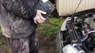 Man Uses Car Battery To Start Another Car's Engine