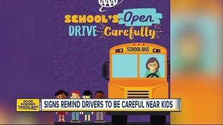 AAA signs popping up near busy roads and school zones reminding people to be careful around kids - Video