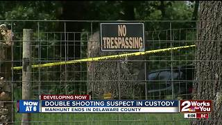 Double shooting suspect in custody - Video