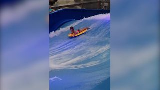 Little Girl Enjoys A Wave Pool