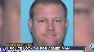 Police looking for armed man - Video