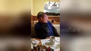 US veteran brought to tears as 'waiter' surprises him - Video