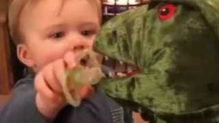 Baby Shares His Dummy With Toy Dinosaur
