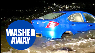 Shocking footage shows a car being washed out to sea