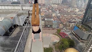 Daredevil stuntman performs extreme tricks on Shanghai skyscraper