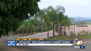 Boy with flashlight casing homes?