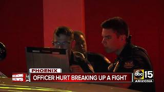 Phoenix officer hurt trying to break up a fight - Video