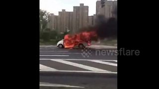 Moving car engulfed by fire - Video