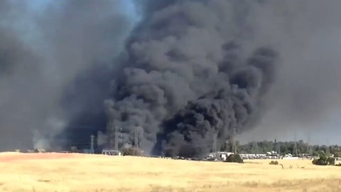 Black Smoke Rises from Stoll Fire in California's Tehama County