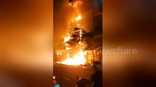Five-story building gutted by fire in just minutes