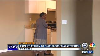 Families return to once flooded apartments - Video