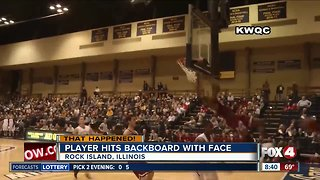 Basketball player hits backboard with face